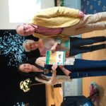 presentation of gold certificate to Anne & John Hill