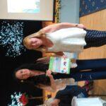 Cllr Carragher presents certificate to Sheila Gallagher
